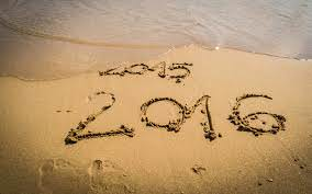 photo of the beach with 2016 written in the sand